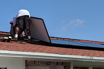 may-custom-home-team-installing-solar-panels